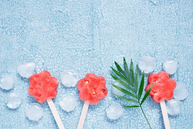 Popsicles of fresh watermelon and ice cubes