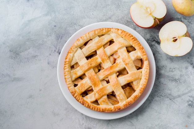 Popular american apple pie on gray table