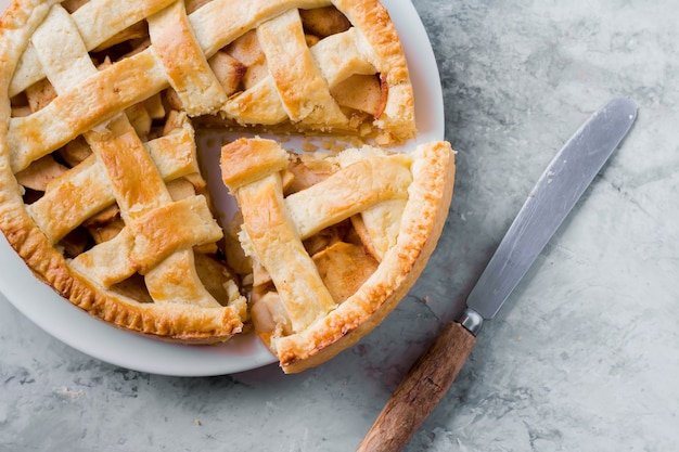 Popular american apple pie on gray table