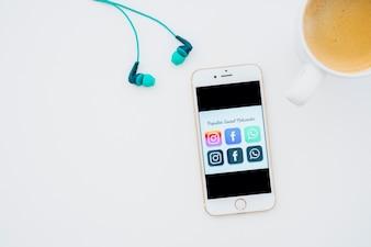 Popular apps, coffee and earphones