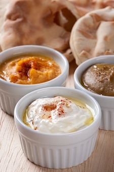 Popular middle eastern appetizer labneh or labaneh, soft white goat milk cheese . curd  cheese