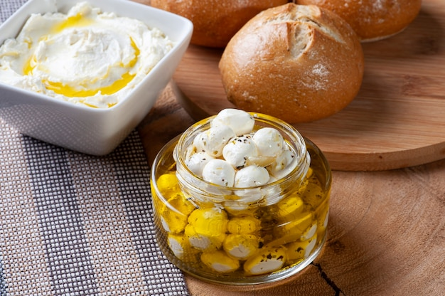 Popular middle eastern appetizer labneh, soft white goat milk cheese with bread