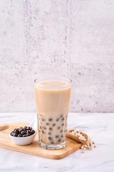 Popular taiwan drink bubble milk tea with tapioca pearl ball in drinking glass