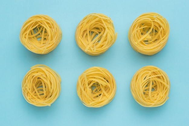 A popular type of pasta on a light blue background. products made of durum wheat.