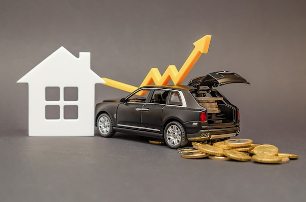 Population income growth. car with coins in the trunk on a black background. arrow pointing upwards as a concept for improving living standards.
