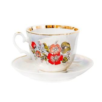 Porcelain cup with floral pattern on saucer isolated on white background