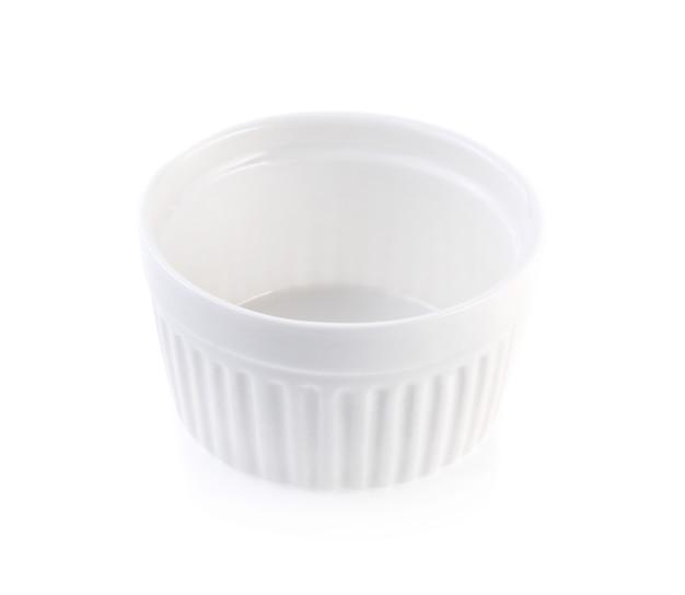 Porcelain souffle ramekin dish isolated on white background