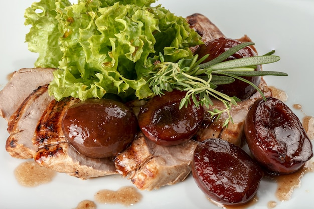 Pork baked with plums