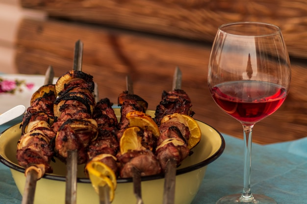 Pork barbecue  with spices, a glass of red wine