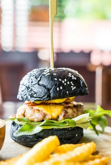 Pork and cheese charcoal burger