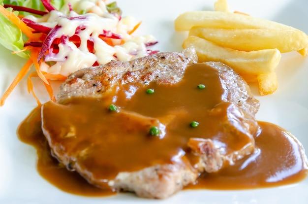 Pork chop steak with brown gravy sauce