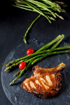 Pork chop with green asparagus