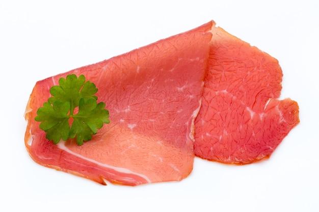 Pork ham slices isolated on white background.