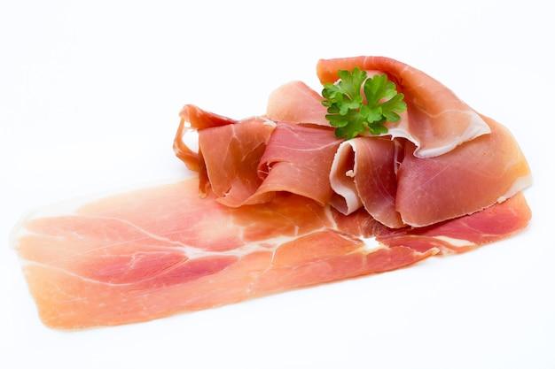 Pork ham slices isolated on white surface.