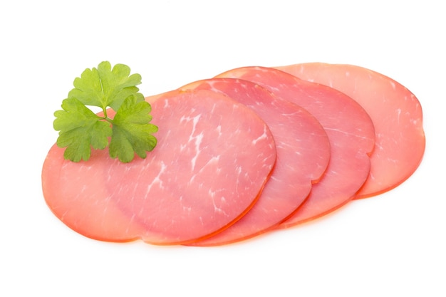 Pork ham slices isolated on white surface.