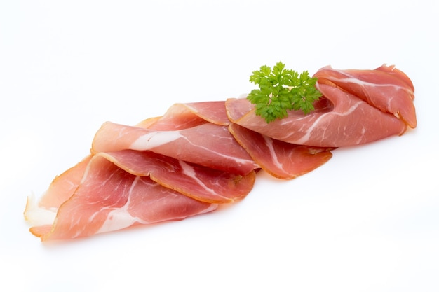 Pork ham slices isolated on white.