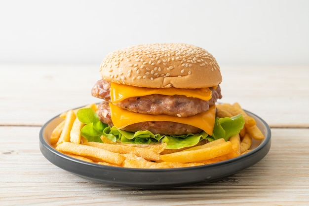 Pork hamburger or pork burger with cheese and french fries