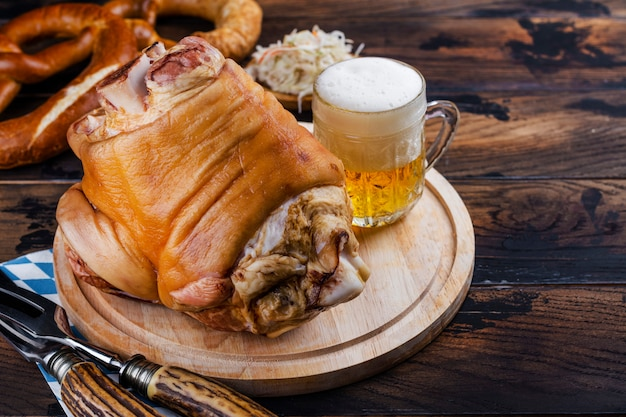 Pork knuckle, beer and pretzels