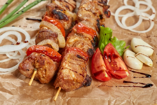 Pork meat kebab with sauces and vegetables