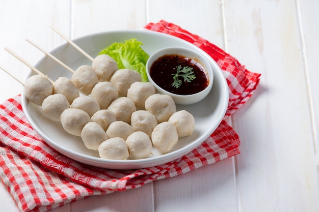 Pork meatballs on the white wooden surface.