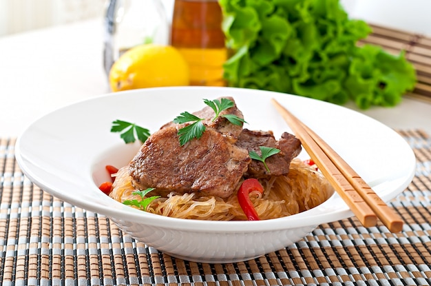 Pork medallions in oyster sauce with noodles