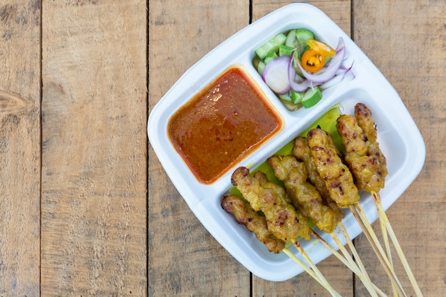 Pork satay grilled pork served with peanut sauce or sweet and sour sauce, thai food