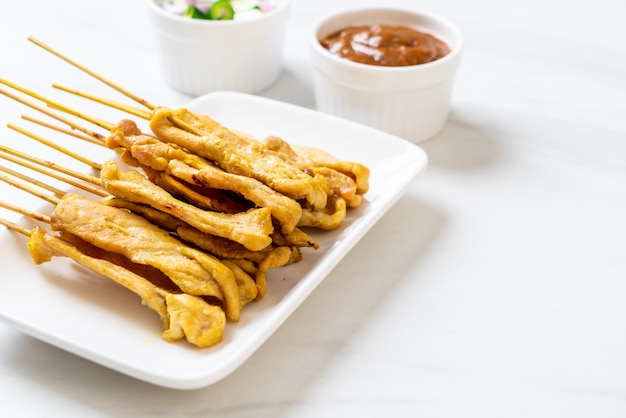 Pork satay - grilled pork served with peanut sauce or sweet and sour sauce