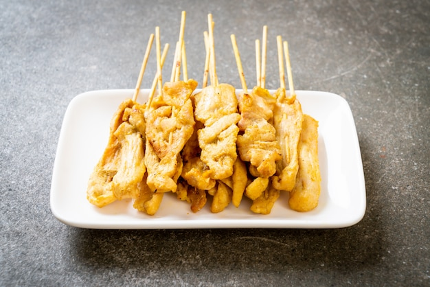 Pork satay   grilled pork served with peanut sauce or sweet and sour sauce