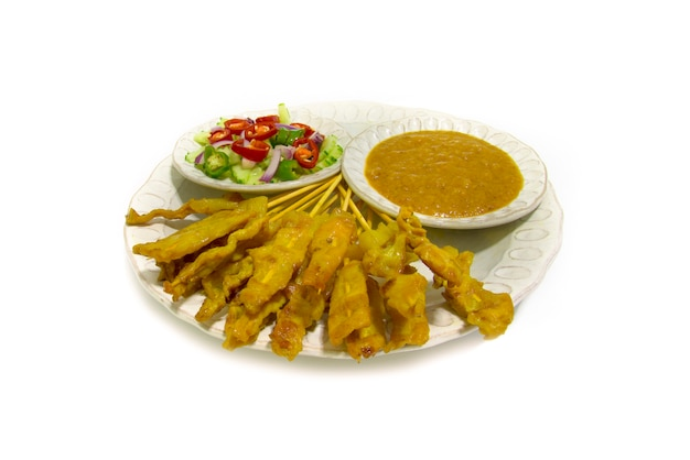 Pork satay with peanut dipping sauce and pickles