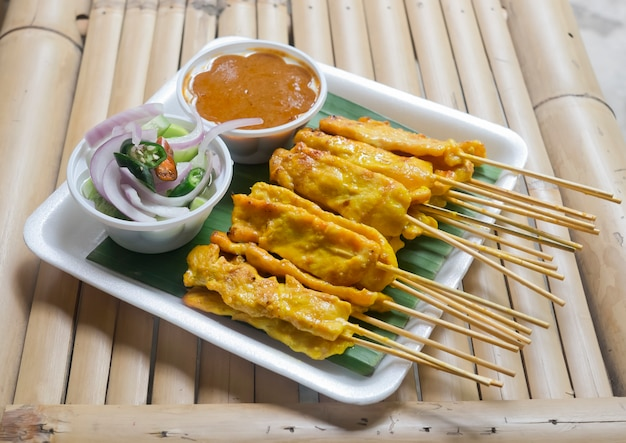 Pork satay with peanut sauce and cucumber relish
