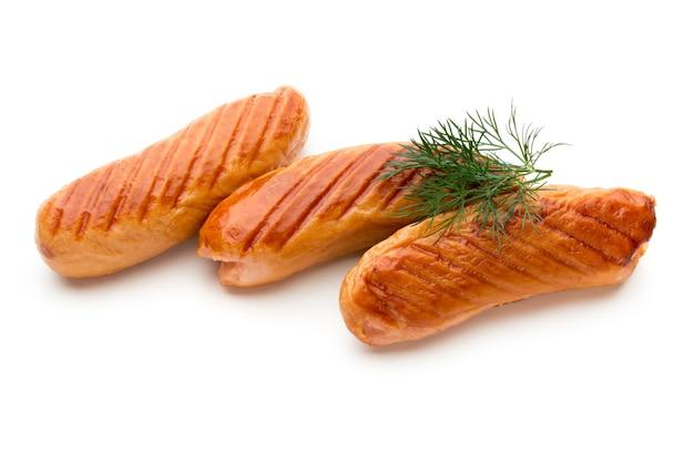 Колбаса и специи из свинины, изолированные на белом фоне.