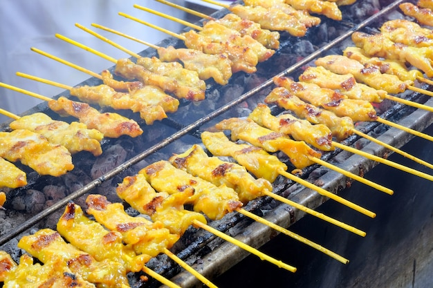Pork skewers grilled on a stove