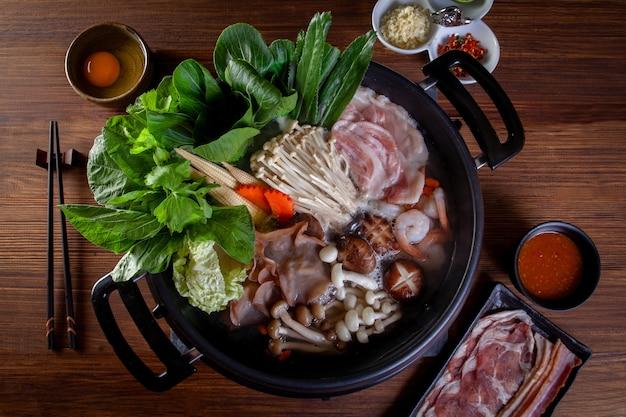 Pork slices vegetable and egg for sukiyaki