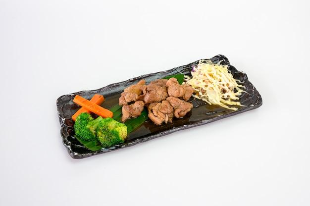 Pork steak slices pepper and cabbage salad