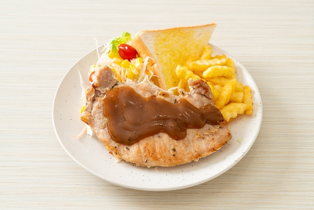 Pork steak with black peppers gravy sauce and mini salad