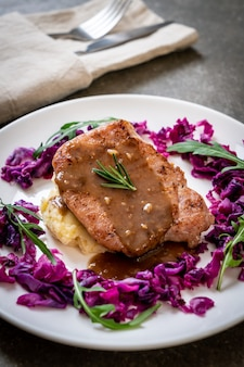 Pork steak with red cabbage and mashed potatoes