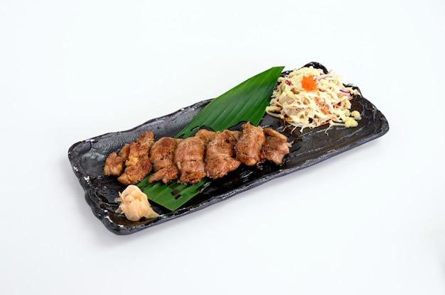 Pork steak with teriyaki sauce and cabbage salad