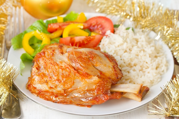 Pork with rice and salad