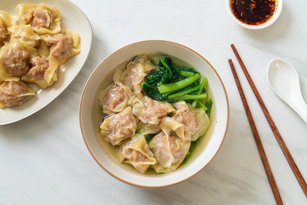 Pork wonton soup or pork dumplings soup with vegetable - asian food style