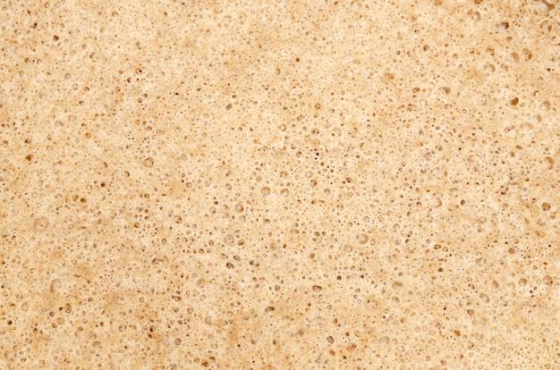 Porous beige texture background
