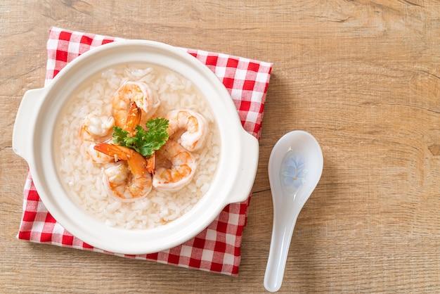Porridge or boiled rice soup with shrimps bowl