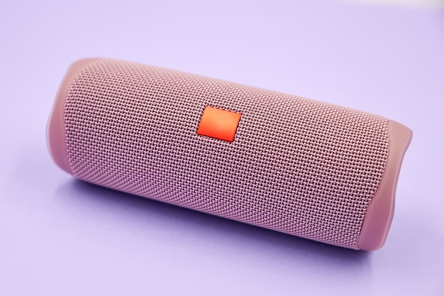 Portable bluetooth and wireless speaker on purple