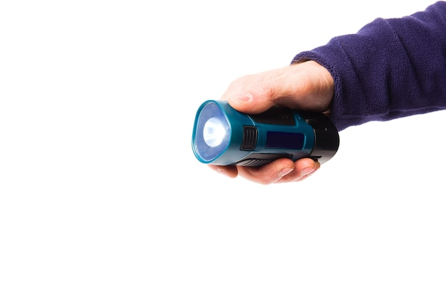 Portable flashlight in a mans hand