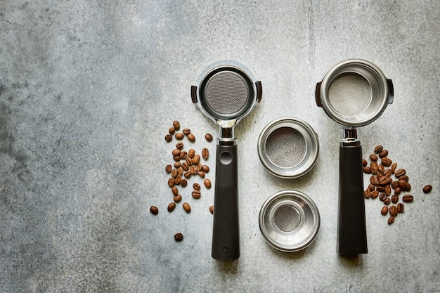 Portafilters for making espresso coffee in a rogue coffee machine, top view with copy space