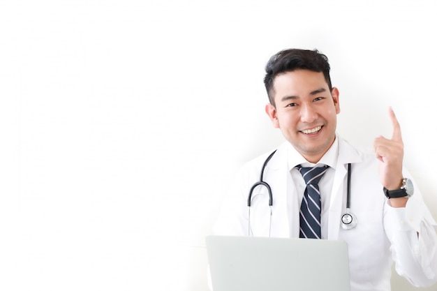 Portait of asian doctor in hospital white