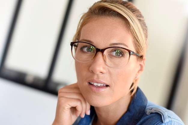 Portait of blond woman with eyeglasses