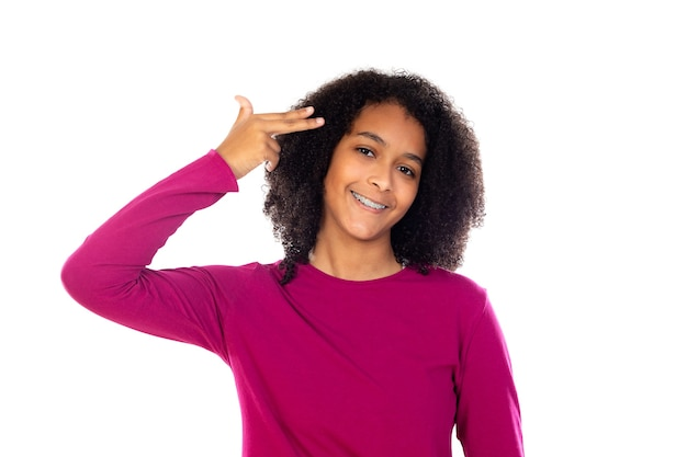 Portait of a teenage with afro hair isolated on a white wall