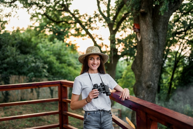 Portait of traveler girl with binoculars.