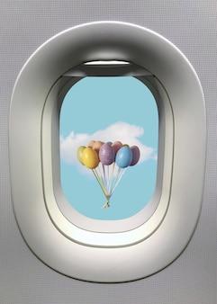 Окно иллюминатора с красочной связкой воздушных шаров пасхальных яиц с белым облаком на голубом небе.