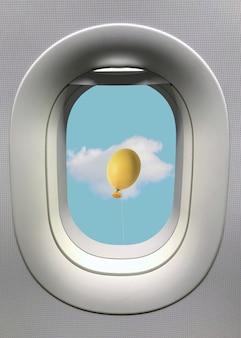 Окно иллюминатора с воздушным шаром пасхального яйца с белым облаком на голубом небе.